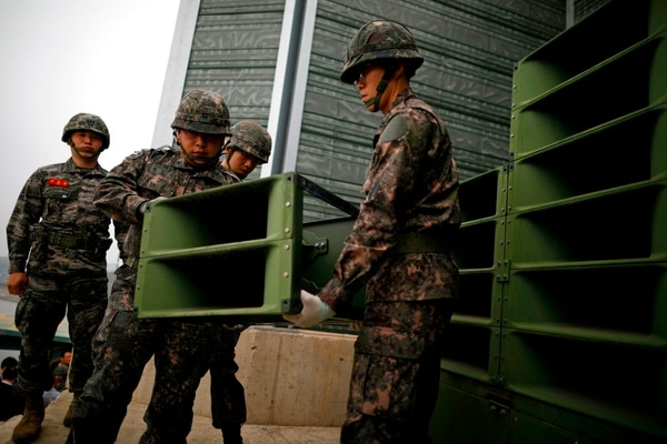 South Korean soldiers dismantle loudspeakers that were set up for propaganda broadcasts near the demilitarized zone separating the two Koreas in Paju, South Korea, Tuesday, May 1, 2018. (Kim Hong-Ji/Pool Photo via AP)