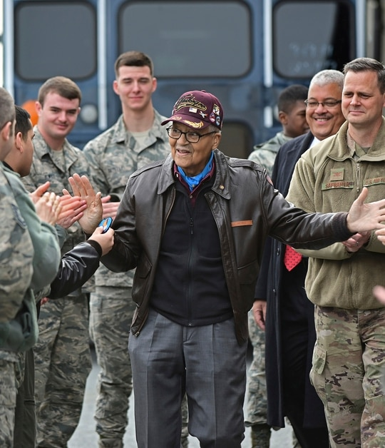 Retired U.S. Air Force Col. Charles McGee, center, a decorated veteran of three wars, receives a congratulatory a send off after visiting with 436 Aerial Port Squadron personnel at Dover Air Force Base to help celebrate his 100th birthday in Dover, Del., Friday, Dec. 6, 2019. McGee's birthday is Dec. 7. (David Tulis/AP)