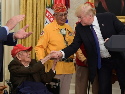 In this Nov. 27, 2017, file photo, President Donald Trump meets with Navajo Code Talkers, Fleming Begaye Sr., seated and Thomas Begay, center, in the Oval Office of the White House in Washington. Begaye Sr. passed away on May 10, 2019, at the age of 97, in Chinle, Ariz. (Susan Walsh/AP)