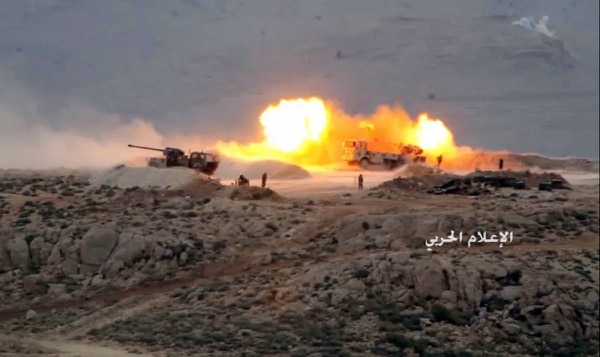 Hezbollah cannons pound militants' positions on the Lebanon-Syria border. (Syrian Central Military Media via AP)