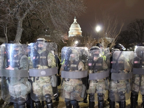 D.C. National Guard arrive to push back protesters from the Capitol on Jan. 6, 2021. (Kyle Rempfer/Staff)