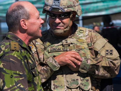 Maj. Gen. Ryan Gonsalves, then the commanding general of the 4th Infantry Division, talks to Chief of the Romanian Land Forces Gen. Maj. Marius Harabagiu during the Getica Saber exercise July 14 in Cincu, Romania. (Spc. Antonio Lewis/Army)