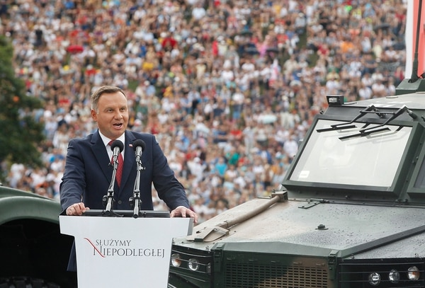 Poland's President Andrzej Duda speaks at the start of Polish National Army Day parade in Warsaw, Poland, Wednesday, Aug. 15, 2018. Poland's president voiced hope for a permanent U.S. military presence in his country as the country put on a large military parade on its Army Day .(AP Photo/Czarek Sokolowski)