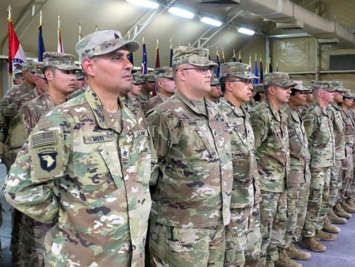 Soldiers of 349th Combat Support Hospital stand in formation during the transfer of authority ceremony at Camp Arifjan, Kuwait, on May 6, 2019. Troops would see a 3.1 percent pay raise under a budget plan unveiled by House appropriators on Tuesday. (Sgt. Connie Jones/Army)