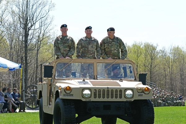 From left, Maj. Gen. Walter Piatt, the incoming commander of the 10th Mountain Division, Gen. Robert Abrams, commander of Army Forces Command, and Maj. Gen. Jeffrey Bannister conduct a pass and review during the 10th Mountain Division change of command ceremony on Fort Drum's Sexton Field on April 27, 2017. (Sgt. James Avery/Army)