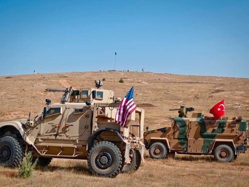 U.S. and Turkish tactical vehicles take a defensive posture during rehearsals at Gaziantep, Turkey, Oct. 14, 2018. These NATO allies have conducted independent coordinated patrols for the past several months. In accordance with the Manbij Roadmap and Manbij Security Principles, U.S. and Turkish military forces continue to work together to ensure security and stability in the region. (Staff Sgt. Timothy R. Koster/Army)