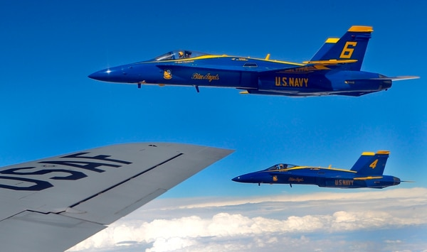The Blue Angels' Lt. Ryan Chamberlain (6) and Nate Barton (4) fly off of the right wing of a KC-135 of the Kansas Air National Guard's 190th Refueling Wing after receiving fuel from it on Wednesday, Sept. 23, 2015, over New Mexico. (Chris Neal/The Topeka Capital-Journal via AP)