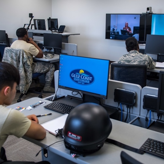 Airmen take a Gulf Coast State College online course at Tyndall Air Force Base in Florida on June 24, 2019. (Senior Airman Anthony Nin Leclerec/Air Force)