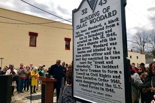 The Blinding of Isaac Woodard historical marker was dedicated in Batesburg-Leesville, S.C., on Saturday, Feb. 9, 2019. The bottom portion of the marker is written in Braille. (Christina Myers/AP)