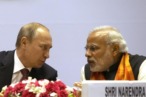 Russian President Vladimir Putin, left, speaks with Indian Prime Minister Narendra Modi in New Delhi on Dec. 11, 2014. (Findlay Kember/AFP via Getty Images)