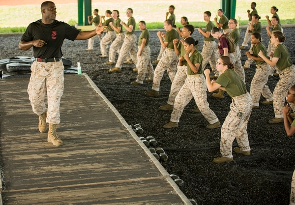 Sgt. Theophlius Bush II, a martial arts instructor, reiterates the importance of a proper fighting stance to recruits of Oscar Company, 4th Recruit Training Battalion, during a martial arts training session June 16, 2015, on Parris Island, S.C. The fighting stance is the foundation of the Marine Corps Martial Arts Program designed to increase the warfighting capabilities of Marines. Bush, 26, is from Jackson, Miss. Oscar Company is scheduled to graduate Aug. 28, 2015. Parris Island has been the site of Marine Corps recruit training since Nov. 1, 1915. Today, approximately 20,000 recruits come to Parris Island annually for the chance to become United States Marines by enduring 13 weeks of rigorous, transformative training. Parris Island is home to entry-level enlisted training for 50 percent of males and 100 percent of females in the Marine Corps. (Photo by Sgt. Jennifer Schubert)