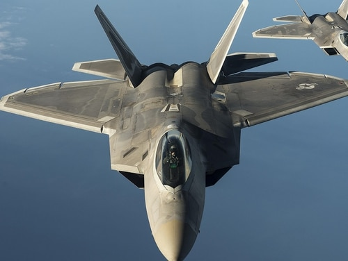 Two F-22 Raptors from the 95th Fighter Squadron at Tyndall Air Force Base, Fla., fly over the Baltic Sea in 2015. The stealth fighters recently returned to Europe, flying training missions with U.S. and allied forces. (Tech. Sgt. Jason Robertson/Air Force)