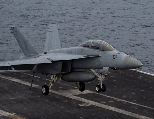 An F/A-18F Super Hornet from Strike Fighter Squadron 22 approaches the flight deck of the aircraft carrier Nimitz while participating in Malabar 2020 in the Arabian Sea Nov. 19. Malabar is a continuing series of exercises that has grown in scope and complexity over the years to address the variety of shared threats to maritime security in the Indo-Pacific. (MC3 Cheyenne Geletka/Navy)