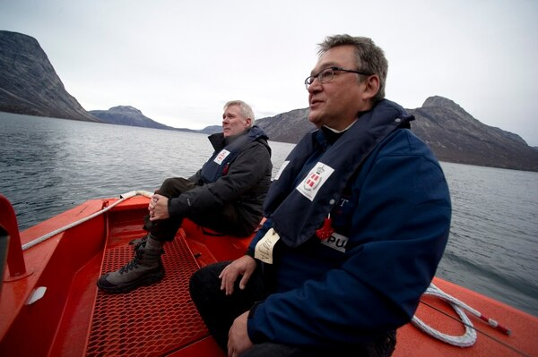 In late 2010, then-Secretary of the Navy Ray Mabus, right, and then-Prime Minister of Greenland Jakob Edvard Kuupik Kleist spoke on board a search and rescue patrol boat off the coast of Nuuk, Greenland. Mabus had been meeting with global leaders and scientists to discuss the environmental impacts of climate change. (Navy)