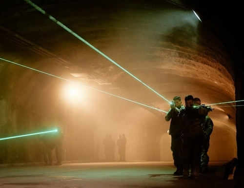 Soldiers use laser aiming devices during underground training. (Army)