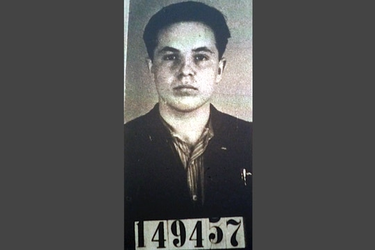 Michael Karkoc is seen here in a photo accompanying his 1940 application for German citizenship filed with the Nazi SS-run immigration office. Karkoc died last month. (U.S. National Archives via AP)