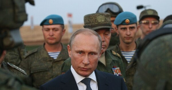 Russian President Vladimir Putin talks to officers during a visit to military exercises at Donguzsky Range in Orenburg, Russia, in September 2015. (Sasha Mordovets/Getty Images)