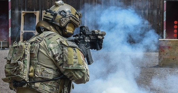 A soldier from the Army's 10th Special Forces Group fires his rifle during a training mission. The Air Force has been spotted recently using EOTech sites like the one atop this soldier's rifle to help sight in their gunship heads up displays. (U.S. Army photo)