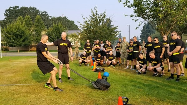 Staff Sgt. Brandon Laspe and Lt. Col. David Feltwell demonstrate how to pull a drag sled as part of a sprint-drag-carry event Aug. 3, 2017. The event was part of a proposed Army Combat Readiness Test, which formed the basis for much of the new Army Combat Fitness Test. (Stephanie Slater/Army)