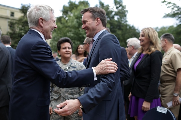 ARLINGTON, VA - JUNE 08: U.S. Navy Secretary Ray Mabus (L) talks to Army Secretary Eric Fanning (R) during a Lesbian, Gay, Bisexual and Transgender Pride Month Ceremony at the Pentagon June 8, 2016 in Arlington, Virginia. The Department of Defense held the event to celebrate the LGBT Pride Month. (Photo by Alex Wong/Getty Images)