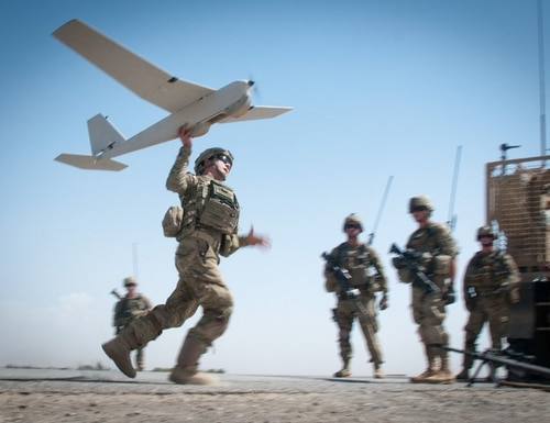 U.S. Army Chief Warrant Officer 2 Dylan Ferguson launches a Puma unmanned aerial vehicle. (U.S. Army/Sgt. Mike MacLeod)