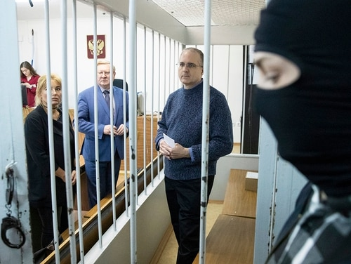 Paul Whelan, a former U.S. Marine, center, who was arrested in Moscow at the end of last year, waits for a hearing in a court in Moscow, Russia, Friday, May 24, 2019. The American was detained at the end of December for alleged spying. (Pavel Golovkin/AP)
