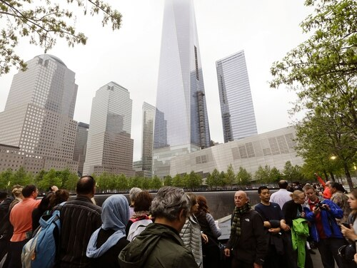 In this May 15, 2015, file photo, visitors gather near the pools at the 9/11 Memorial in New York. (Frank Franklin II/AP)