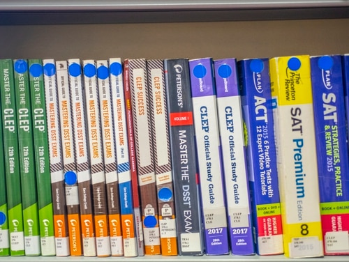 Test preparation books sit on the shelf at the base library Oct. 9, 2019, at RAF Mildenhall, England. (Airman 1st Class Joseph Barron/Air Force)