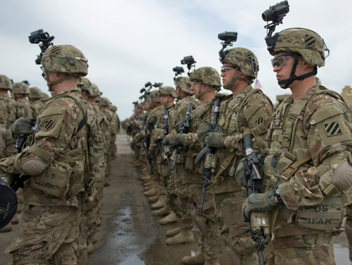 Soldiers from the 3rd Infantry Division stand in formation before an exercise in Europe. The Army plans to continue growing the force in 2018, the service's top personnel officer said. (Sgt. Daniel Cole/Army)