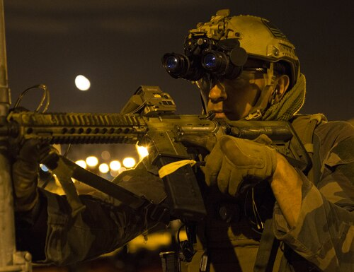 Marine Raiders with 1st Marine Raider Battalion, U.S. Marine Corps Forces, Special Operations Command, provide security while conducting a simulated night-raid on a warehouse in Los Angeles in 2015. (Sgt. Scott A. Achtemeier/Marine Corps)