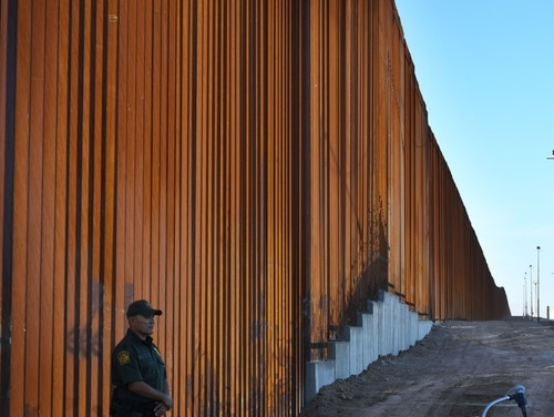 Border Patrol officers keep watch at the first completed section of President Donald Trumps 30-foot border wall in the El Centro Sector, at the U.S.-Mexico border in Calexico, Calif., on Oct. 26, 2018. (Mark Ralston/AFP via Getty Images)