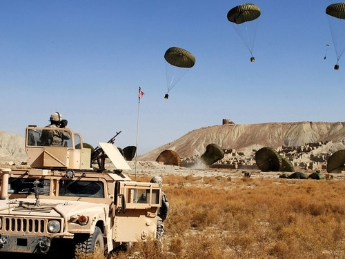 U.S. paratroopers from the 82nd Airborne Division watch as C-17 Globemaster IIIs drop combat cargo bundles carrying food and water in Paktika Province, Afghanistan, in 2007. (Spc. Micah E. Clare/Army)