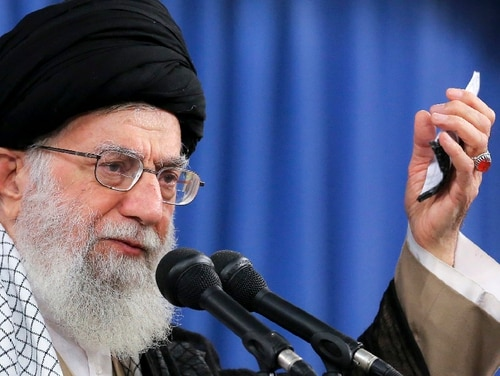 In this photo released by an official website of the office of the Iranian supreme leader, Supreme Leader Ayatollah Ali Khamenei speaks at a meeting in Tehran, Iran, Monday, Aug. 13, 2018. Khamenei said Monday he is banning any negotiations with Washington while stressing that Iran has no intentions of entering into a war with the United States. (Office of the Iranian Supreme Leader via AP)