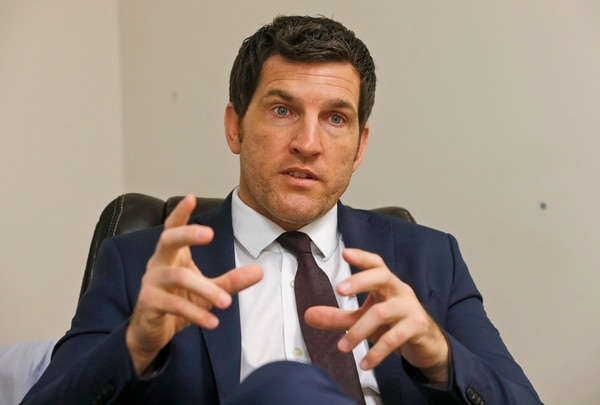 In this Friday, Oct. 7, 2016, photo, Virginia's 2nd District Congressman Scott Taylor speaks during an interview in his campaign office in Virginia Beach, Va. Taylor is among a cadre of former Navy SEALs who've recently ascended to major elected office. (AP Photo/Steve Helber)
