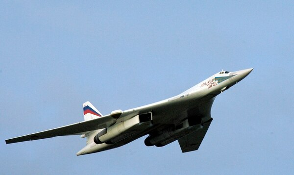 In this Aug. 16, 2005, file photo, a supersonic Tu-160 strategic bomber with Russian President Vladimir Putin aboard flies above an airfield near the northern city of Murmansk. The Russian military says two of its nuclear-capable strategic bombers have arrived in Venezuela, a deployment that comes amid soaring Russia-U.S. tensions. (Alexei Panov/Sputnik, Kremlin Pool Photo via AP)