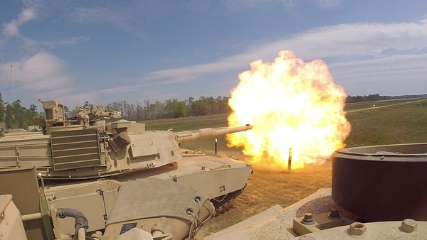 Troopers with Delta Tank Company, 6th Squadron, 8th Cavalry Regiment, 2nd Armored Brigade Combat Team, 3rd Infantry Division, fire the main gun during unit gunnery March 29 at Fort Stewart, Georgia. This gunnery marked the first time 2nd ABCT troopers fired their newly delivered M1A1-SA Abrams tanks since the brigade converted from a light to an armored brigade combat team. (Pfc. Calab Franklin/Army)