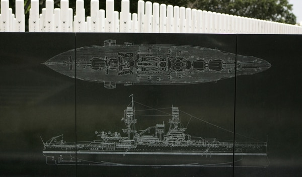 In this April 24, 2015, photo, the USS Oklahoma is engraved on a memorial wall at Pearl Harbor in Honolulu. (Caleb Jones/AP)