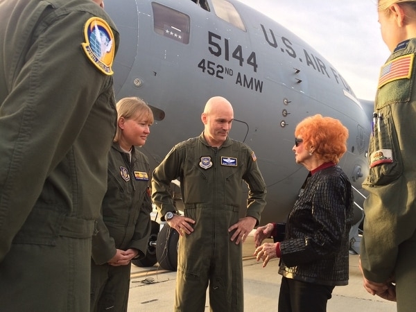 Gen. Carlton Everhart, the head of Air Mobility Command, chats with Elinor Otto. Everhart flew Otto, along with a group of JROTC cadets, on a C-17 as part of a