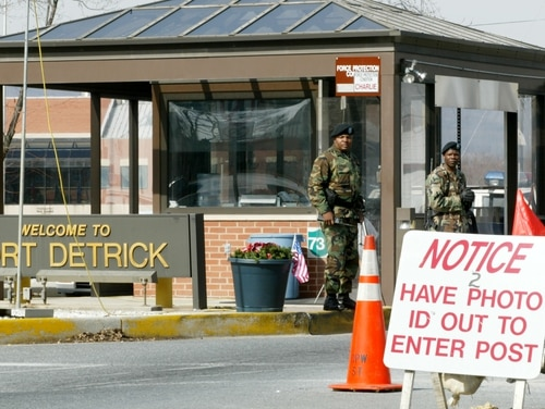 401533 01: Two soldiers stand guard February 25, 2002 at the main gate of Fort Detrick in Frederick, Maryland, where the U.S. Army Medical Research Institute of Infections Diseases is located. The FBI said on Monday that they don''t have a prime suspect of the anthrax attack that killed five people last year. (Photo by Alex Wong/Getty Images)
