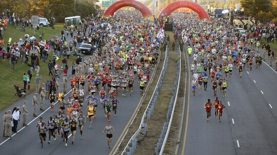 Runners begin at the start of the 39th Marine Corps Marathon, Sunday, Oct. 26, 2014 in Arlington, Va. The race included runners from 59 nations and each branch of the U.S. armed forces. (Alex Brandon/AP)