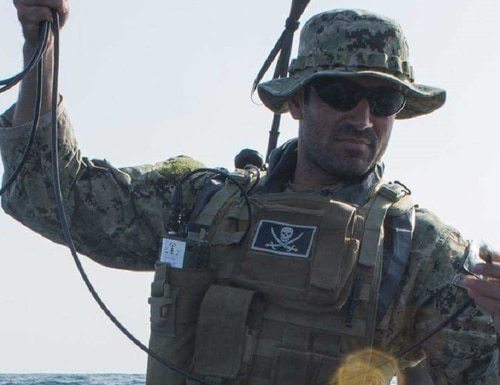 Senior Chief Hull Maintenance Technician Mario Pais, seen here during a training exercise, stepped in to help rescue an injured civilian mariner in March. (Navy)
