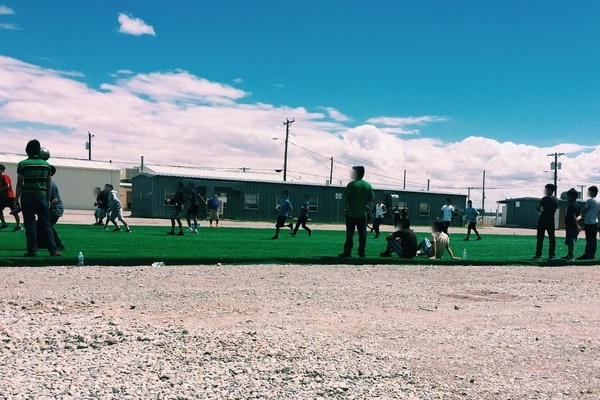 More than 7,200 immigrant children who arrived at the U.S. border alone were temporarily housed at Fort Bliss, Texas, in 2016 and 2017. Some are shown here playing soccer. (Department of Health and Human Services)