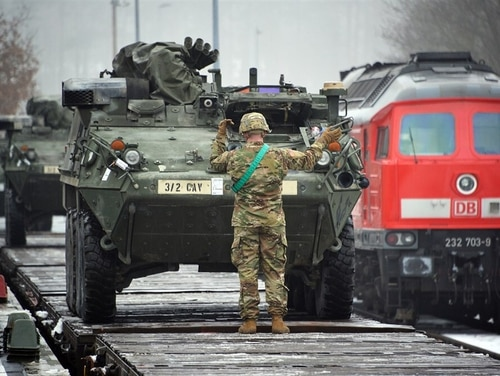 U.S. soldiers assigned to Lightning Troop, 3rd Squadron, 2nd Cavalry Regiment, load Stryker Fighting Vehicles on rail cars at Rose Barracks' railhead station in Vilseck, Germany, in 2016. (U.S. European Command)