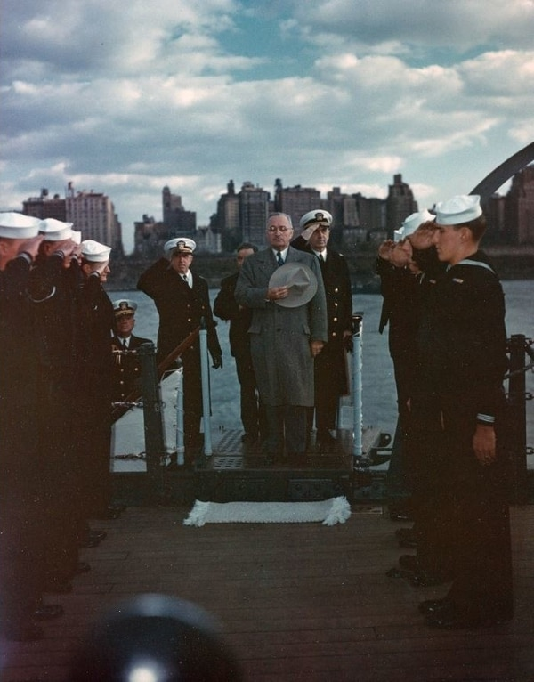 President Harry S. Truman is piped aboard the battleship Missouri during the Navy Day fleet review in the Hudson River, New York City, 27 October 1945. Fleet Admiral William D. Leahy is just behind the President. (National Archives)