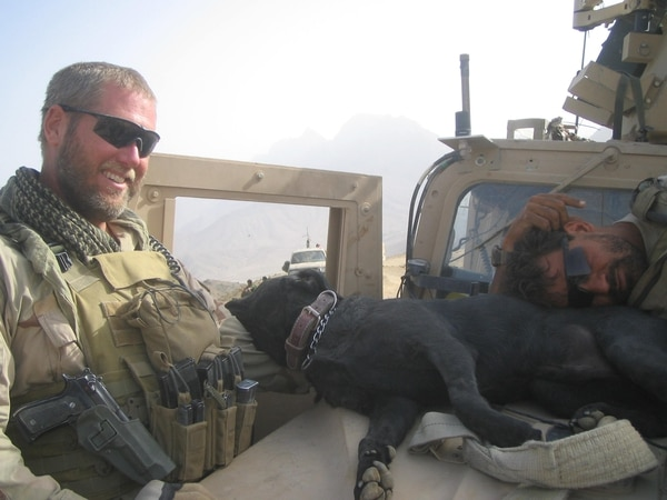 Then-Army Sgt. Dennis Dow relaxes with Sgt. Jag on deployment. (Courtesy photo)