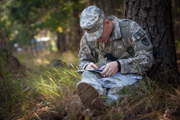 U.S. Army Staff Sgt. Kevin Hopson, representing theArmy Material Command, plots points on a map during the Land Navigation portion of the annual Best Warrior competition in Fort Lee, Va., Oct. 9, 2014. The Non-Commissioned Officer's physical, leadership capabilities and critical thinking skills are put to the test for a chance to earn the prestigious army-wide title of Best Warrior. (U.S. Army photo by Spc. Alexandra Campo/Released)