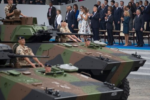 Tanks parade past President Donald Trump, first lady Melania Trump, French President Emmanuel Macron and his wife Brigitte Macron, during Bastille Day parade in Paris on July 14, 2017. Defense Department officials are planning a similar U.S. event for this fall. (Carolyn Kaster/AP)