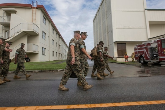 Commandant of the Marine Corps Gen. Robert B. Neller walks with Maj. Gen. Richard L. Simcock II, commanding general, 3d Marine Division, before a town hall at Camp Hansen, Okinawa, Japan, Oct. 13, 2016. (Cpl. Samantha K. Braun)