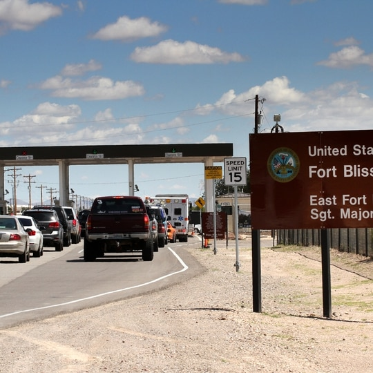 This Sept. 9, 2014, file photo shows cars wait to enter Fort Bliss in El Paso, Texas. (Juan Carlos Llorca/AP)