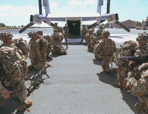 Paratroopers from the 173rd Airborne Brigade, based in Italy, prepare to file into a Marine MV-22B Osprey. (Cpl. Tawanya Norwood/Marine Corps)